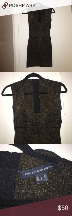 French Connection Bandage Dress Beautiful bandage dress, black base with gold sparkle threading. Wore this to a New Years party one year - was a huge hit! Size 2, runs very small I'm usually an XS or 00z French Connection Dresses Mini