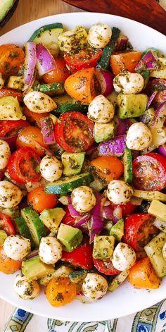 Avocado Salad with Tomatoes, Mozzarella, Cucumber, Red Onions, and Basil Pesto with lemon juice