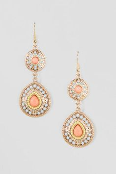 Under $20! The Lupe Drop Earrings are vibrant but in a simple chic way. Features beads in pastel purple, peach and yellow with a hint of mint paint set on round & teardrop plates