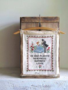 Vintage Cross Stitch Sampler - love how it's displayed on a hanger.