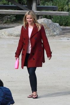 Reese Witherspoon wearing Burberry Trench Coat and S'well Bikini Pink 17-Oz. Reusable Bottle
