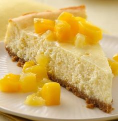 The Piña Colada cocktail is a popular drink that features the flavors found in this cheesecake. The combination of orange, pineapple, coconut and rum combine for a marvelous, tropical-inspired cheesecake. Pina Colada Cheesecake Recipe, Pina Colada Cake, Mango Cheesecake, Cheesecake Recipes, Dessert Recipes, Coconut Cheesecake, Graham Crackers, Just Desserts, Holiday Desserts