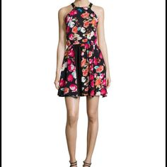 Floral Print Racerback Dress Floral print woven dress with solid crepe panels. Round neckline, button keyhole back. Sleeveless, fit and flare silhouette. Hidden side zip rayon, polyesters. Lined Romeo & Juliet Couture Dresses Mini