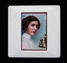 The Royal Mail released a set of special stamps featuring some of the characters, favourite droids, aliens and creatures of the Star Wars films. This 1st class stamp design shows Princess Leia. Princess Leia Organa is princess of the planet Alderaan. She is seen as a strong character and many view her as a feminist hero. She was played in the films by Carrie Fisher. This unique and handmade brooch is an eye-catching piece, ideal to wear at any Comic Con. Star Wars Princess Leia, Presentation Cards, Strong Character, Star Wars Film, Carrie Fisher, Brooches Handmade, Royal Mail, Design Show, Postage Stamps