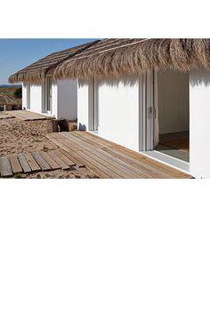 Beach cabins near Lisbon on Portugeuese coast.