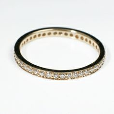 A beautiful channel set eternity ring set with brilliant cut diamonds all around the ring. The ring is made in 18ct yellow gold and the total diamond weight for this ring is 0.34ct. The total weight of the ring is 1.5gms. This ring is also available in 18ct white gold. Please contact our Marlborough Showroom for sizes.