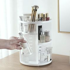 The 360 Rotating Makeup Organizer is the ultimate time saver! No more searching for makeup that's at the bottom of your beauty bag or dropping it all over the floor. This handy organizer is ideal for keeping all of your make-up clean and well-organized. Diy Makeup Organizer, Make Up Organizer, Organiser Box, Makeup Organization, Beauty Organizer, Organization Ideas For Bedrooms, Bathroom Product Organization, Toiletry Organization, Shelf Organizer