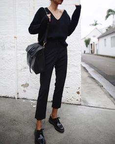 black pants black top sweater bag