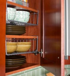 Space-Saving Ideas for Making Room in the Kitchen: Shelving space inside Sarah and John's wall-mounted cabinets is maximized with stackable wire racks. The racks come in different heights and widths…More Small Kitchen Organization, Kitchen Storage, Organization Ideas, Kitchen Pantry, Kitchen Shelves, Kitchen Dishes, Kitchen Tools, Cocina Diy, Diy Kitchen Cabinets