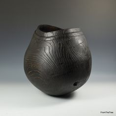 A carved & scorched oak vessel. made by G.Watkins