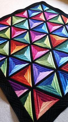 I am in love with this quilt!  It's bright rich colours and dimension just make it come alive.  It's actually more like a piece of art than...