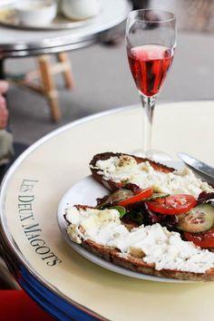 Goat cheese toast and rosé wine at Les Deux Magots, Paris