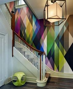 Cole & Son Circus wallpaper with art deco staircase and lamp.