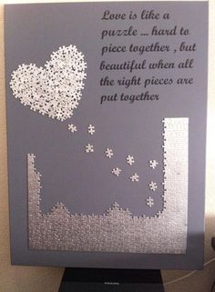 "Puzzle Piece Wall Decor instructions: paint an 11""x14"" flat canvas white & spray it with"