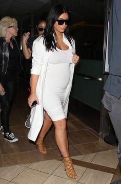 Kim Kardashian Photos - Pregnant Kim Kardashian Arriving On A Flight At LAX - Zimbio