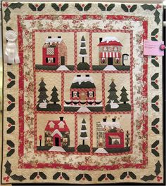 """""""Holiday Lane"""" by Lori Hemmingsen-Souza, quilted by Brandy Rice, Holly Lane design by The Quilt Company.  Photo by Quilt Inspiration"""