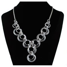 """Three sizes of rings nest inside each other, creating a light and airy scallop. This necklace is finished into a dramatic Y shape. It looks great over a solid-color sweater, or with a plunging neckline shirt. Aluminum with rhodium-finish chain. Approx 21.5"""" long."""