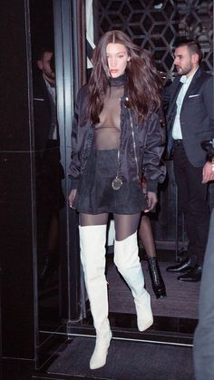 Sheer top, black suede miniskirt and white thigh boots