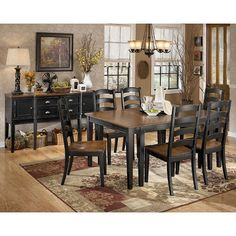 The rich cottage beauty of the Owingsville Formal Dining Room Set by Signature Design by Ashley Furniture uses a rich medium brown finish on chair seats and table tops contrasting the painted black color of the table base and chair legs to create a stylish two-tone cottage look that is sure to add a warm inviting atmosphere to any dining area.