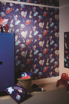 A wallpaper which is out of this world! A fun wallpaper design featuring aliens, planets, astronauts and spaceships.