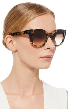 **Thierry Lasry's** Nevermindy style is crafted in a chunky cat eye formula with gradient lenses.