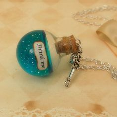 Iridescent Alice in Wonderland 'drink me' necklace  by amarese, $15.95