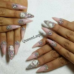 Sculpted rose nail art with bling! Click to see a whole gallery of 3-D sculpted acrylic nail art.