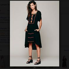 "Free People Folk Embroidered mini maxi Dress FABULOUS FREE PEOPLE BLACK MID LENGTH ""FOLK EMBROIDERED DROP WAIST SHIFT DRESS"" - Square neck with embroidered trim - Short sleeves - Cutout back with embroidered details - Embroidered and pintucked front panel - Layered skirt with tiered front embroidered panels NEW WITH TAGS  *  SIZE: X SMALL retail:  $148.00  Fiber Content: Shell: 83% cotton, 17% rayon Lining: 100% cotton  Measurements: 18"" under arm to arm (36"" around ) 36"" around waist…"