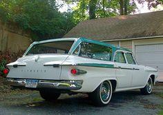 yup i can see me driving this!! 1961 Plymouth Custom Suburban Wagon.