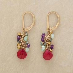 """EXUBERANCE EARRINGS--A burst of glittering stones and 14kt goldfilled beads gathers around the warm glow of a faceted ruby. 1-3/8""""L."""