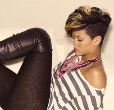 Rihanna's short brown and black hairstyle