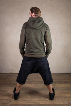 The Jumper Anakin gives an Assassins Fashion and Jedi like look. The hood has a deep star wars and ninja cut. The inside lining has a grunge trash polka print. There is also a secret pocket inside to keep your treasures save.  This post apocalyptic men jumper is made of 100% Cotton Terry and has to