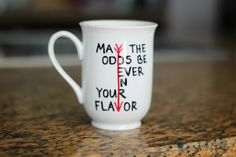 May the odds be ever in your favour Hunger Games coffee mug.
