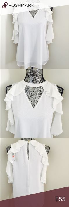 NWT!! Michael Kors gorgeous white blouse! This is a gorgeous white ruffled blouse made by Michael Kors! It is a size extra small with a beautiful cut out design over the chest!                                                        This comes NEW WITH TAGS!                       Retail price is $130!                                             Accepting offers!                                                Please ask any questions before purchasing! KORS Michael Kors Tops Blouses