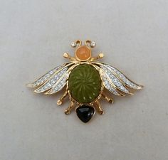 DESIGNER SIGNED JOAN RIVERS MELON CARVED LUCITE BELLY WINGED RHINESTONE BUG PIN