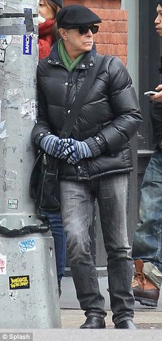 David Bowie looks unobtrusive wandering around New York... as he goes public…