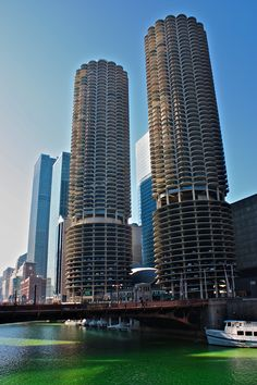 The Marina Towers overlooking a dyed green Chicago River around St. Patrick's Day.
