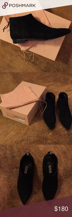 Miu Miu black suede boots Size 36.5 pointy toe, black suede miu miu booties. Only worn a handful of times, comes with original box and dust bag. Miu Miu Shoes Ankle Boots & Booties