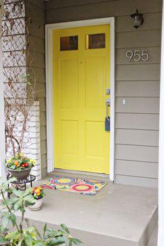 grey house + yellow door