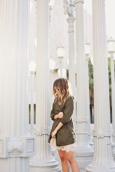 army green jacket over delicate nude slip dress