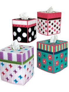 Stylish and trendy tissue toppers in plastic canvas.   Decorate your home with polka dots, flowers and butterfly tissue toppers! Each topper is made using 7-count plastic canvas and fits a standard boutique-tissue box.