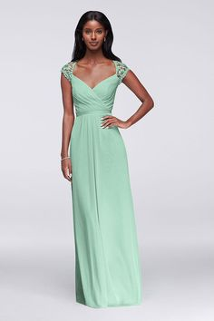 This Mint-colored mesh and lace bridesmaid dress is designed with pretty details like lace cap sleeves and a keyhole back. Find more styles to mix and match at David's Bridal.