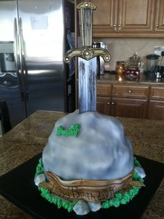 sword in the stone - mixed chocolate and vanilla cakes, fondant covered, airbushed. Sword was purchased at Party City and stuck in at the last.