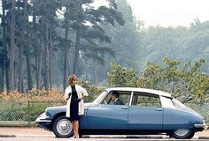 Citroen DS - the citroen and the orange tiger lilies make this look exactly like my family and childhood.