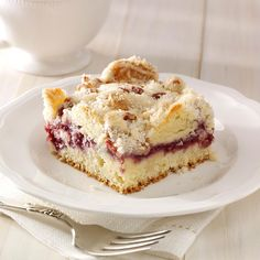 Raspberry Streusel Coffee Cake Recipe -One of my mother's friends used to bring this over at the holidays, and it never lasted long. With the tangy raspberry filling, tender cake and crunchy topping, it has become a favorite at our house. -Amy Mitchell, Sabetha, Kansas