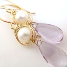 Delicate pearl and amethyst earring by Aubepine at Etsy.