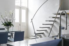 Floating Staircase. Luxurious ground floor apartment with two bedrooms, two bathrooms & separate w.c and utility room. Interior designed throughout with mezzanine floor. Open plan Boffi stainless steel kitchen. Master bedroom has a modern open plan en-suite bathroom with black granite flooring. #openplankitchen #kitchengoals #dreamkitchen #baffikitchen #floatingstaircase #openplanbathroom #ensuitbathroom #bathroomgoals #bedroomdesign #interiordesign #luxuryproperty #mezzanine