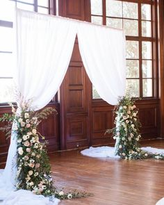 How's this for a floral arch at the altar? Elegant draping flows flanking the couple and pretty cascading flowers accented below. Purple Wedding Tables, Pastel Wedding Theme, Wedding Reception Layout, Wedding Table Names, White Wedding Bouquets, Wedding Reception Decorations, Wedding Ceremonies, Wedding Guest Etiquette, Wedding Centerpieces Mason Jars