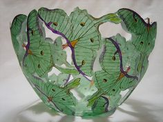 Blown clear and green layers into the bowl shape, then green etched off to create butterflies, then painted.