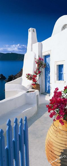 Santorini, Greece  Even if in reality the Mediterranean ends up only being half as vivid a blue as it appears to be, it will be breathtaking!